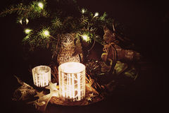 Christmas decoration with pine branches, reindeer and candleligh Royalty Free Stock Image