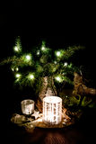 Christmas decoration with pine branches, reindeer and candleligh Stock Photos