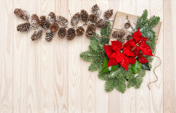 Christmas decoration Pine branches wrapped gift poinsettia flowe Stock Photos