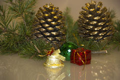 Christmas decoration pine cone. Christmas decoration on reflective surface Royalty Free Stock Photography