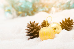 Christmas decoration and pine cones against lights blur balckgro Royalty Free Stock Photography