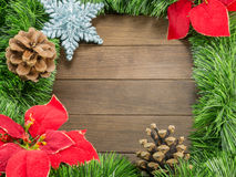 Christmas decoration with pine cones, poinsettia and a star on w Royalty Free Stock Image