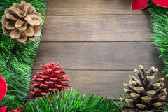 Christmas decoration with pine cones and poinsettia on wooden ba Royalty Free Stock Images