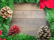 Christmas decoration with pine cones and poinsettia on wooden ba Stock Photo