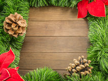 Christmas decoration with pine cones and poinsettia on wooden ba Stock Images