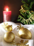 Christmas decoration with pine tree. Balls and red candle stock image