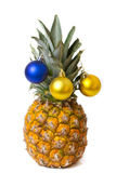 Christmas decoration on pineapple Royalty Free Stock Image
