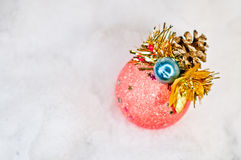 Christmas decoration with pinecone on white snow Stock Photos