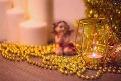Christmas decoration with praying angel and lit candle Stock Photos