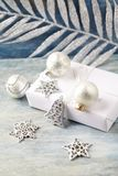 Christmas decoration and present. Christmas bell and silver baubles. stock image