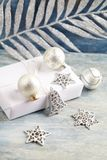 Christmas decoration and present. Christmas bell and silver baubles. royalty free stock photography