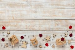 Christmas decoration with presents, snowflakes and stars. On a wooden background Stock Images