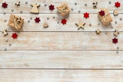 Christmas decoration with presents, snowflakes and stars on a wo. Oden background Royalty Free Stock Photos