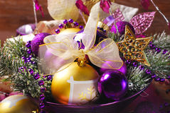 Christmas decoration in purple and golden colors Royalty Free Stock Photos