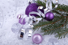 Christmas decoration purple silver on white snow Royalty Free Stock Images