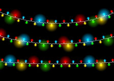 Christmas decoration realistic luminous garland on black. Background. Lights effects. Glowing lights for Xmas Holiday greeting card design. Isolated vector Stock Photo
