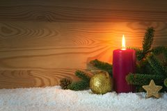 Christmas decoration and red Advent candle. Christmas card. Royalty Free Stock Photo