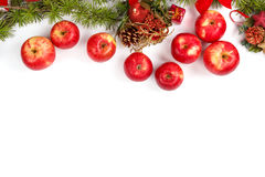 Christmas decoration with red apples and green fir tree. Wonderful Christmas decoration with red apples and green fir tree on white surface with copyspace Royalty Free Stock Photo