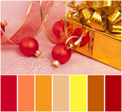 Christmas Decoration on a red  background and colour palette Stock Images