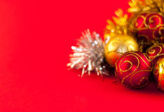 Christmas decoration on red background. Christmas decoration, red gold and silver, on red background Royalty Free Stock Image