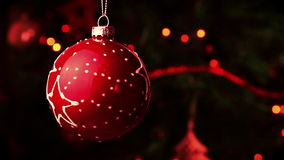 Christmas decoration red ball.  christmas tree lights bokeh. Christmas decoration red ball. abstract blurred bokeh holiday background. christmas tree lights stock video footage