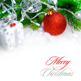 Christmas Decoration with Red Ball, Green Fir Branch and White Lights in Snow. Greeting Card Royalty Free Stock Images