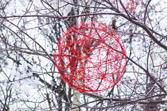 Christmas decoration red ball of yarn hanging on tree royalty free stock photo