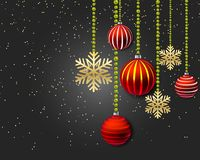 Christmas decoration with red balls and gold snowflakes on a black background. Royalty Free Stock Images