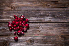 Christmas decoration: red balls on old wooden rustic background. Stock Image