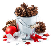 Christmas decoration red balls pinecone in bucket Stock Photos