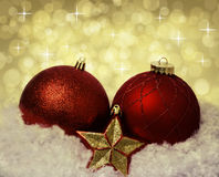 Christmas decoration red balls on the snow Stock Images