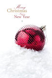 Christmas decoration with red bauble and snow  (with easy remova Royalty Free Stock Photo