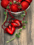 Christmas decoration with red baubles and hearts Royalty Free Stock Image