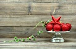Christmas decoration with red baubles. Vintage arrangement Stock Photo