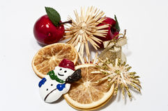 Christmas decoration in red and beige. Christmas decoration with an apple an a snowman Stock Photos