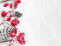 Christmas Decoration with Red Berries and Pine Cones Royalty Free Stock Photos