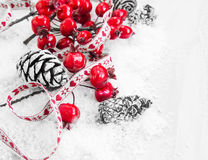 Christmas Decoration with Red Berries and Pine Cones Royalty Free Stock Photography