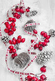 Christmas Decoration with Red Berries and Pine Cones Royalty Free Stock Photo
