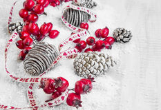 Christmas Decoration with Red Berries and Pine Cones Royalty Free Stock Image