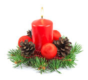 Christmas decoration with red candle. Pine cones, spruce branches on white background Stock Photos