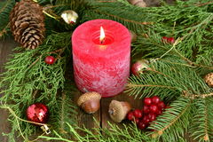 Christmas decoration and red candle burning Royalty Free Stock Image