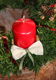 Christmas decoration with red candle and branches on tree tr. Unk royalty free stock photos