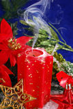 Christmas decoration with red candle with smoke Stock Image