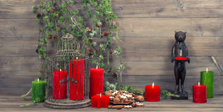 Christmas decoration with red candles, birdcage and pine branche Royalty Free Stock Image