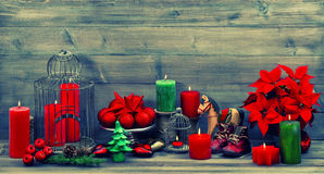 Christmas decoration with red candles and flower poinsettia Royalty Free Stock Images