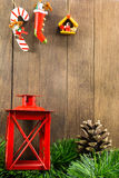 Christmas decoration with red candlestick and brown pine cone on Stock Images