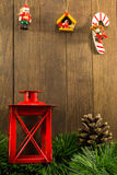 Christmas decoration with red candlestick and brown pine cone on Royalty Free Stock Photography