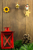 Christmas decoration with red candlestick and brown pine cone on Stock Image