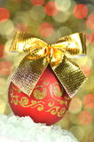 Christmas decoration, red Christmas ball with golden bow Stock Image