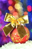 Christmas decoration, red Christmas ball with golden bow Stock Images
